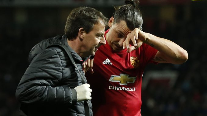 Manchester United's Zlatan Ibrahimovic receives medical attention after sustaining an injury